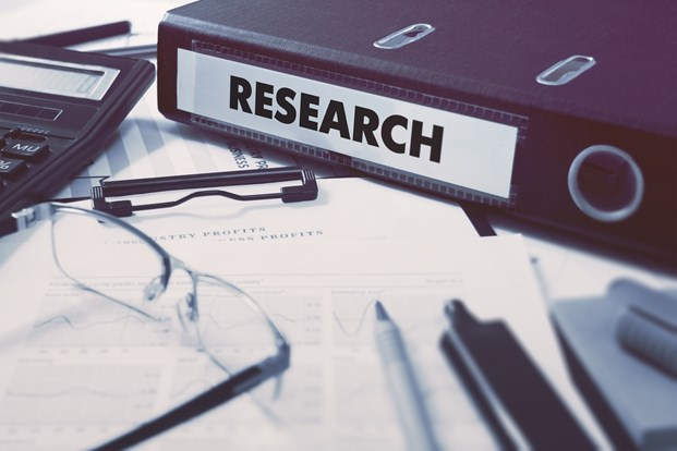 Clinical research regulatory binder checklist with Research written on the side of the folder.